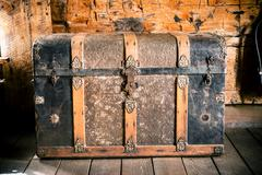 Vintage wooden chest. aged treasure chest in the old house. Stock Photos