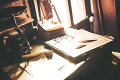 Vintage desk with glasses. Stock Photos