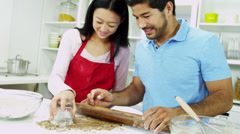 Happy Young Ethnic Couple Home Kitchen Biscuit Baking - stock footage