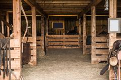 old wooden barn interior. barn photo - stock photo
