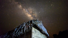 Milky Way Timelapse Above Bamboo Huts Slide Backward Stock Footage
