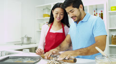 Asian Chinese Female Red Apron Male Kitchen Baking Fun Together - stock footage