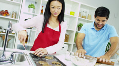 Close Up Happy Young Ethnic Couple Home Kitchen Biscuit Baking Stock Footage
