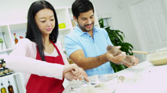Smiling Asian Chinese Male Female Baking Organic Cookies Stock Footage