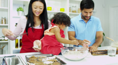 Close Up Happy Young Ethnic Family Home Kitchen Biscuit Baking - stock footage