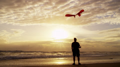 Sunset Silhouette Male Outdoors Beach Flying Toy Kite Stock Footage
