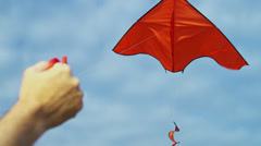 Close Up Male Hand Brightly Colored Toy Kite Flying Wind - stock footage