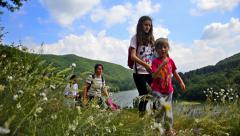 hikers hiking in beautiful landscape. hiking family woman and children trekki - stock footage
