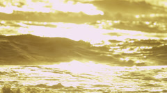 Sunset Reflecting Gentle Rolling Ocean Waves Stock Footage