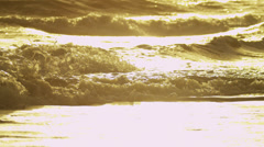 Sunset Light Over Gentle Ocean Waves Breaking Deserted Shoreline Stock Footage