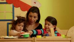 6of15 Little child, girl, educator, teacher playing in kindergarten, preschool Stock Footage