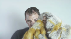 Man and fur coat Stock Footage