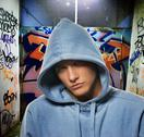 Stock Photo of cool looking hooligan in a graffiti painted gateway