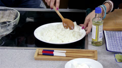 Mixing Rice for Sushi Stock Footage
