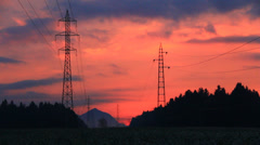 Electric transmission line in sunset Stock Footage