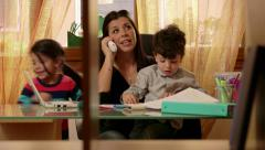 7of15 Little children, girl, boy, woman, business, multitasking mother working Stock Footage