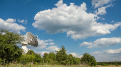 The parabolic antenna on a background of the blue sky - stock footage