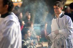 malaga, spain - april 09: nazarenes and musicians from semana santa (easter) - stock photo