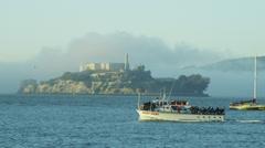 Tourists vessel Alcatraz Island sea fog Bay, San Francisco, California, USA Stock Footage