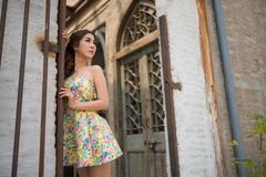 Vintage girl standing lean against door Stock Photos