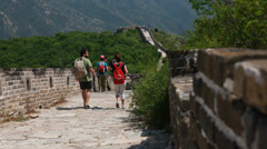 Tourists hiking great wall of china on a mountain jiankou section Stock Footage