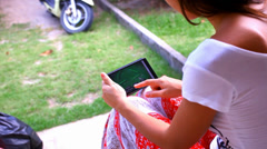 Woman using mobile phone touch screen. Paying a game on her phone. Video Stock Footage
