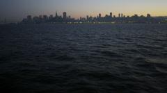 Port of San Francisco illuminated sunset dusk Skyscrapers San Francisco Bay, Stock Footage
