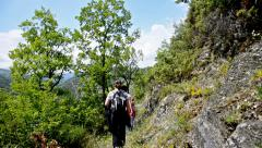 Hiking walking on trail. healthy lifestyle hiker people walking in mountains. Stock Footage
