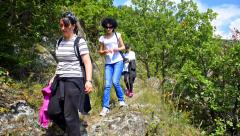 Hiking family woman and children on hike on forrest path in macedonia Stock Footage