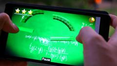 Close up of woman hand using mobile phone touch screen. Playing a game on her Stock Footage
