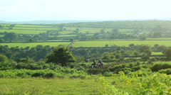 cyclists on the moor - stock footage