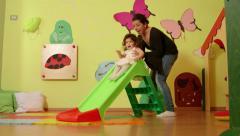 11of15 Little child, baby, educator, teacher playing in kindergarten, school Stock Footage