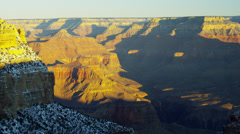 Grand Canyon ravine National Park panning sunrise snow in winter, Arizona, USA - stock footage