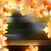 Autumn Leaves over wooden background. EPS10 - stock illustration