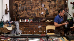 Craftsman work in the leather workshop Stock Footage