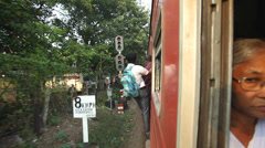 Man hanging off train exterior while train is moving. Stock Footage
