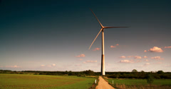 A big windmill on standby on a green field fs700 4k raw odyssey 7q Stock Footage