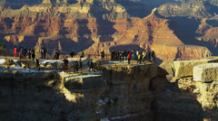 Time lapse Grand Canyon tourists cliff face colourful rock layers, Arizona, USA Stock Footage