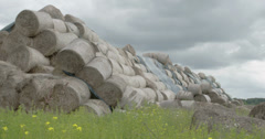 The heap of rolls of hay balls in the field  fs700 4k raw odyssey 7q Stock Footage