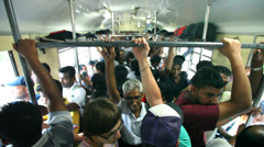 Crowded comuter train full of people on the way to the capital Colombo. Stock Footage