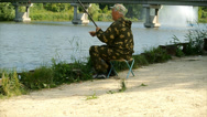 Stock Video Footage of The Fisherman  On River  Shore