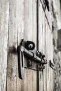Old bold on a wood door Stock Photos