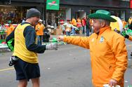 Stock Photo of staff giving water to runner on chicago marathon event