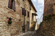 Stock Photo of narrow street in the old town in italy
