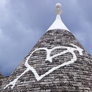 low angle view of a heart shape painted on a trulli house, alberobello, bari, - stock photo
