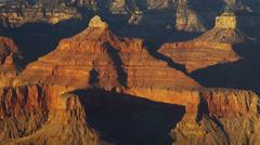 Grand Canyon National Park panning cliffs sunrise winter rock, Arizona, USA Stock Footage