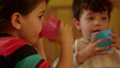 13of15 Little children, kids, eating, drinking in kindergarten, school Stock Footage