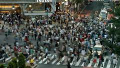 BUSY CROSSWALK - TOKYO'S FAMOUS CROSSWALK IN SHIBUYA Stock Footage