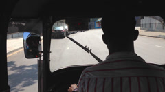 View of local traffic from inside a tuktuk. Stock Footage