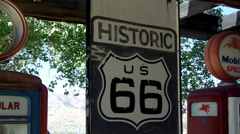 Historic Route 66 Sign Between Old Time Gas Pumps- Hackberry AZ Stock Footage